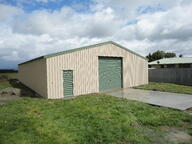 Enclosed shed with roller door