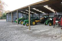 This wide implement shed has plenty of space for large machinery