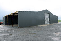 This farm storage shed has a lean-to for additional storage
