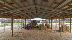 Timber poles and steel rafters are both functional and stunning
