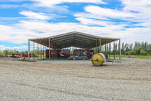 Moving large machinery is easy with this tall clearspan shed