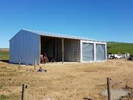half enclosed and half open farm shed