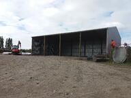 This farm storage shed has an open front for ventilation while still protecting its contents from any harsh weather