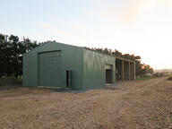 The part-open bays on the farm shed make access simple and efficient