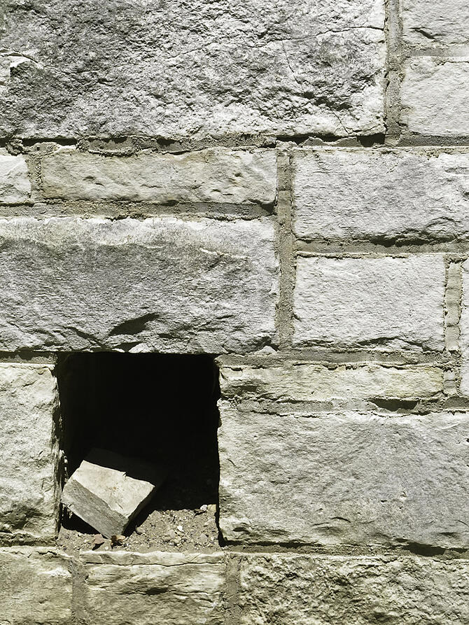 Possibility of buried treasure in architectural breach Mysterious hole in exterior wall of stone and mortar