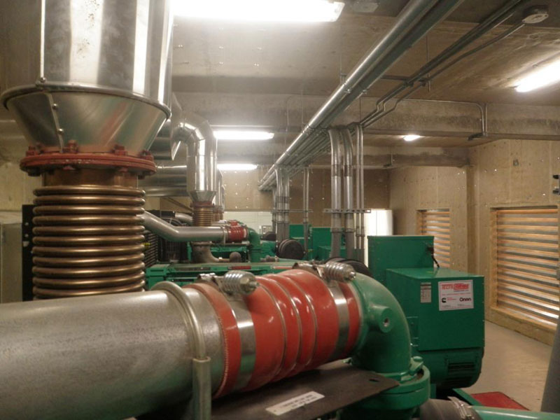 Noise was lowered by adding QuietFiber to the walls and ceilings of this enclosed generator room. QuietFiber is easy to install on stick pins on virtually any surface and is available in white and black.