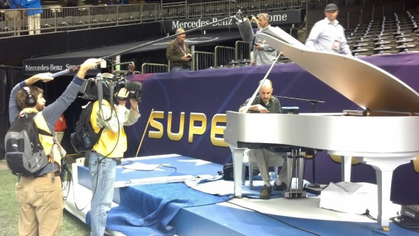 Seale Keyworks tuning the Super Bowl piano on site