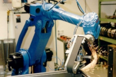 Motoman Finishing Robot sanding and buffing an industrial part