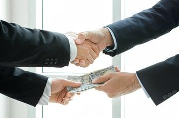Donation or Bribe? Non-Profit Insurance and Broker Donations