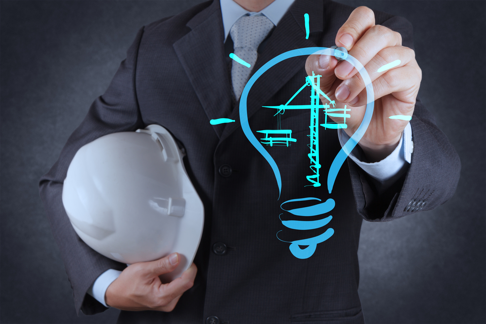 engineer drawing lightbulb and construction as concept