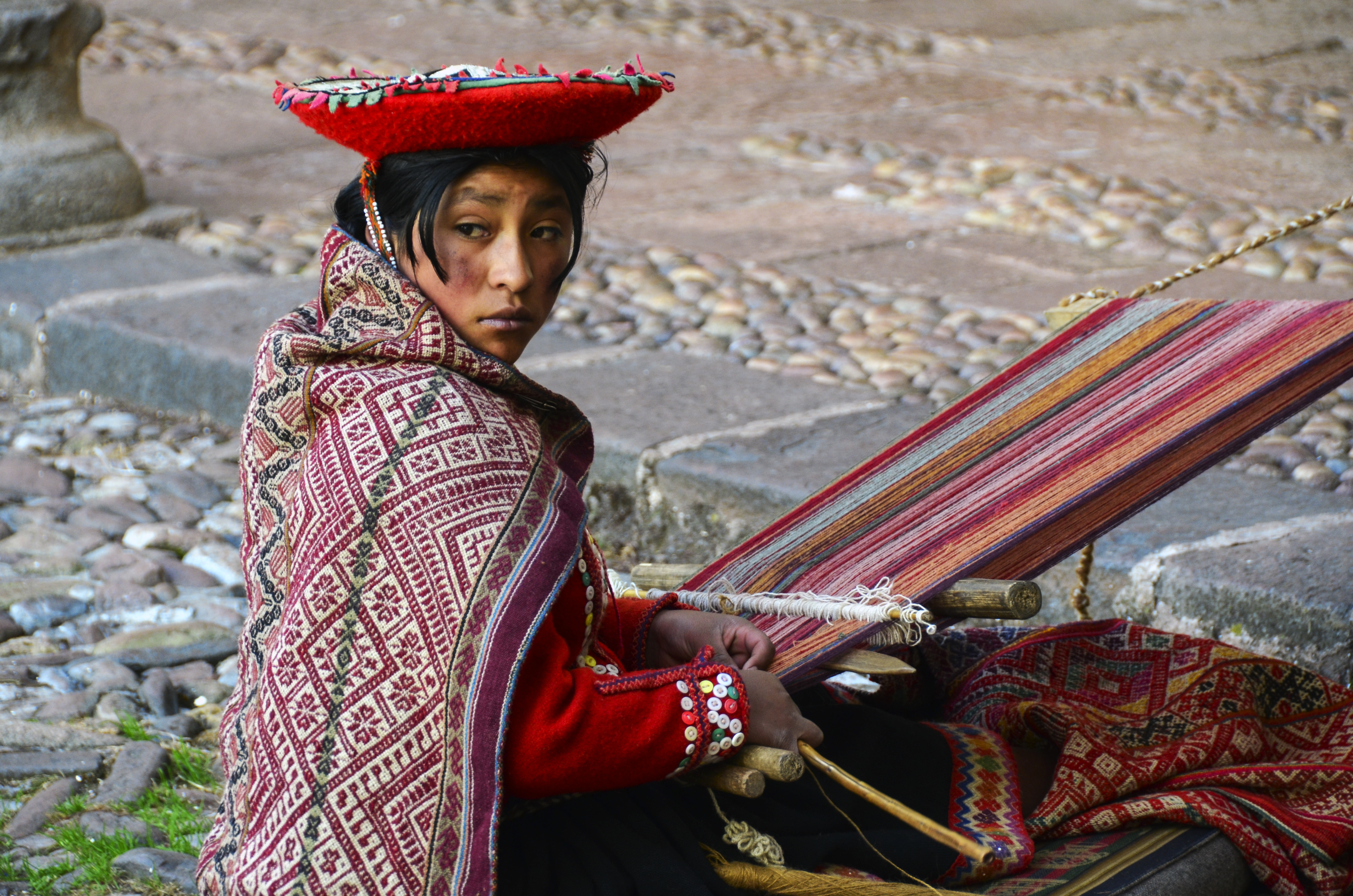 Young artisan weaver in colorful clothing