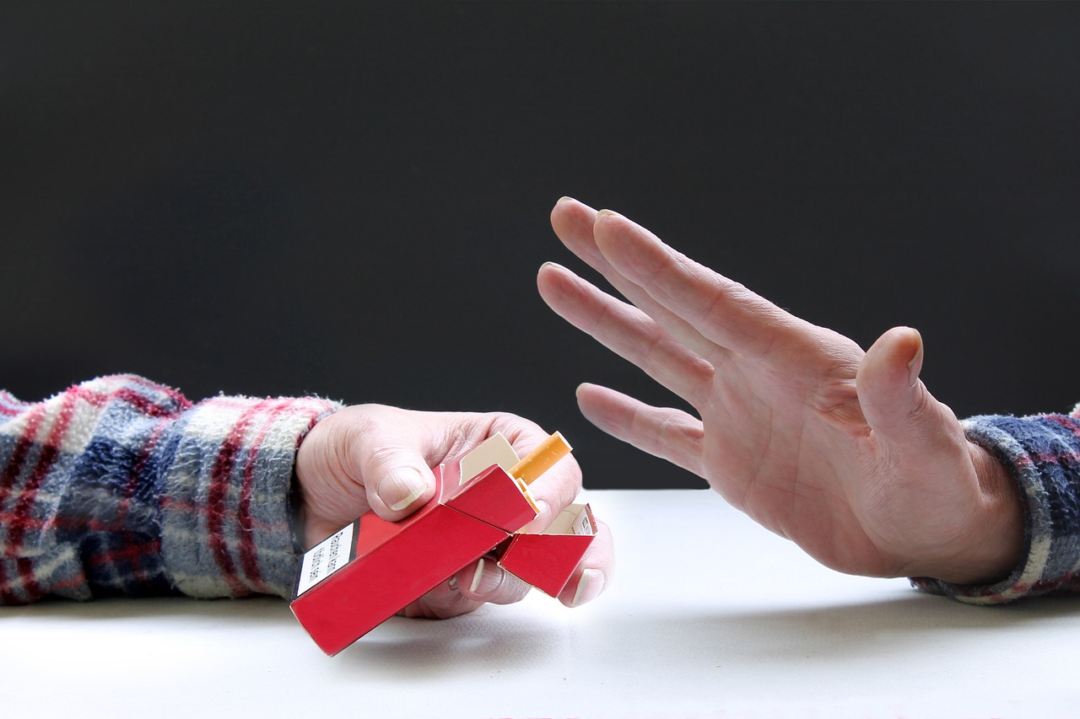 hand gesturing no to cigarette