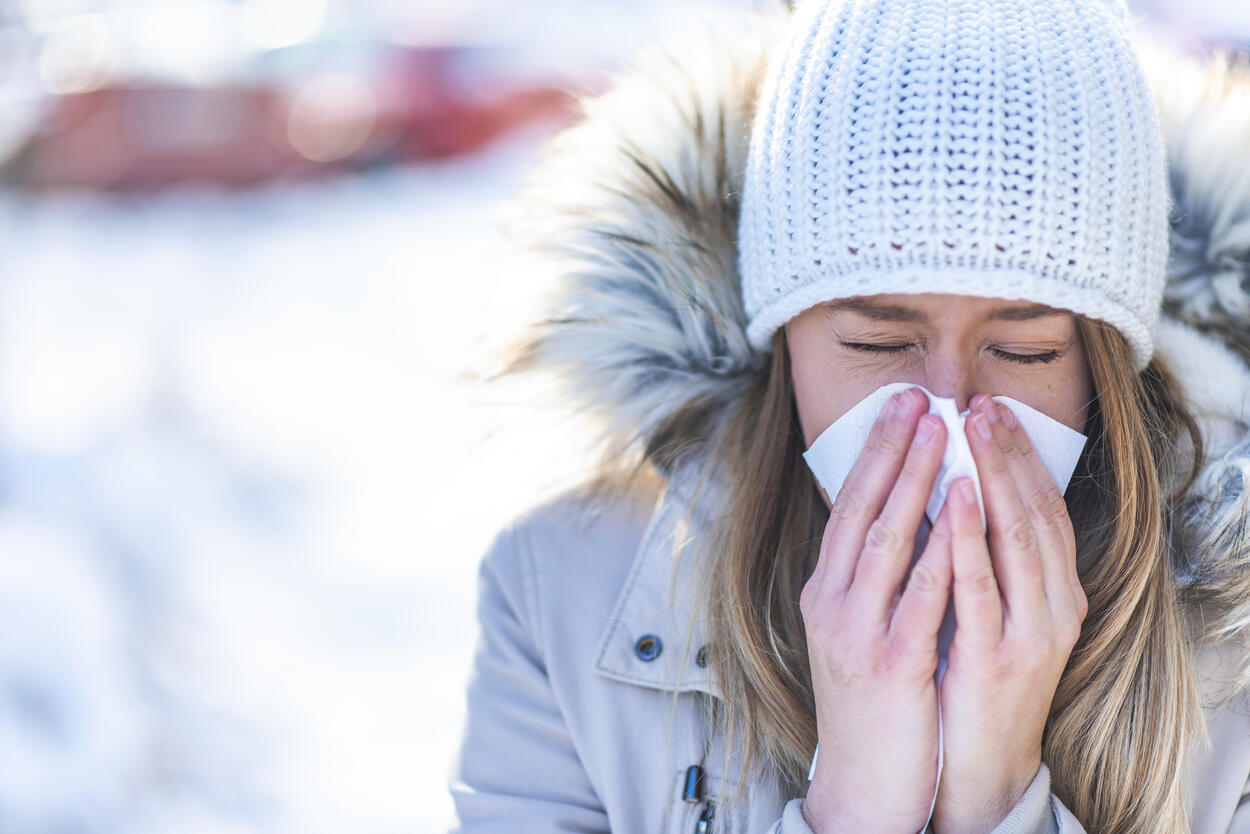 women-blowing-nose-outside-in-winter