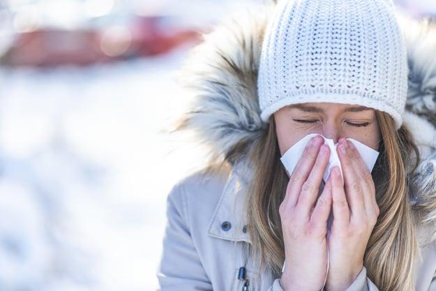 women-blowing-nose-outside-in-winter