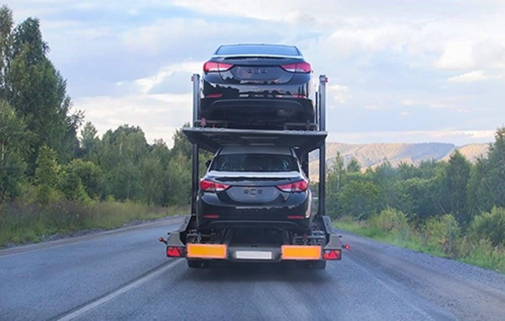 cars on truck - blog