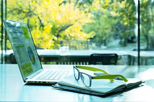 glasses laptop in front of window-blog.jpg
