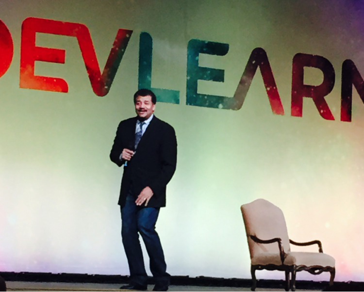 Neil DeGrasse Tyson engaging the crowd on day 1 of DevLearn