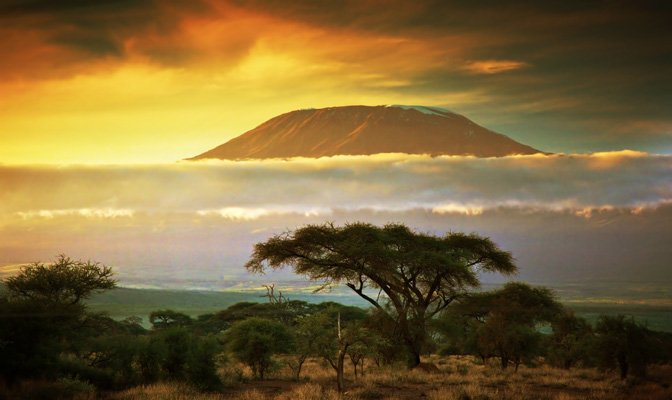 bigstock-Mount-Kilimanjaro-and-clouds-l-42312406.jpg