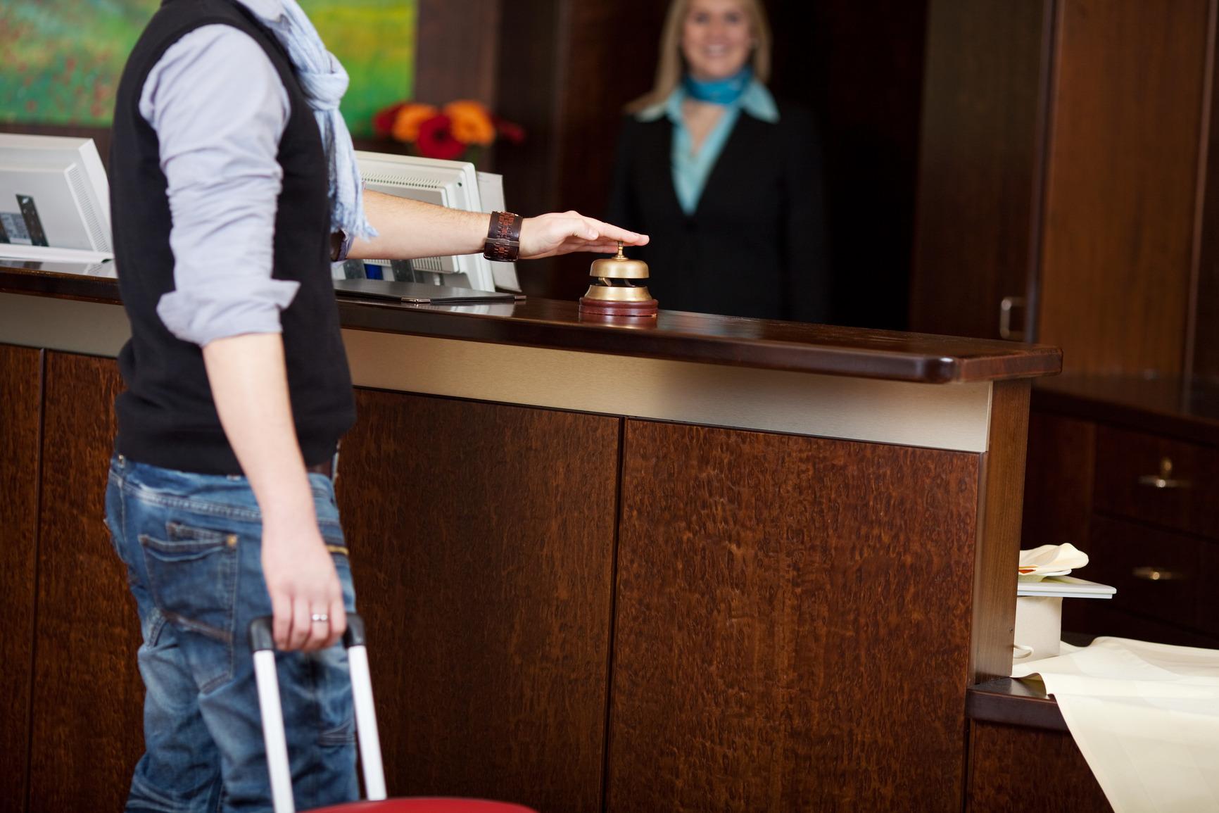 photodune-4864294-costumer-ringing-bell-at-hotel-counter-m