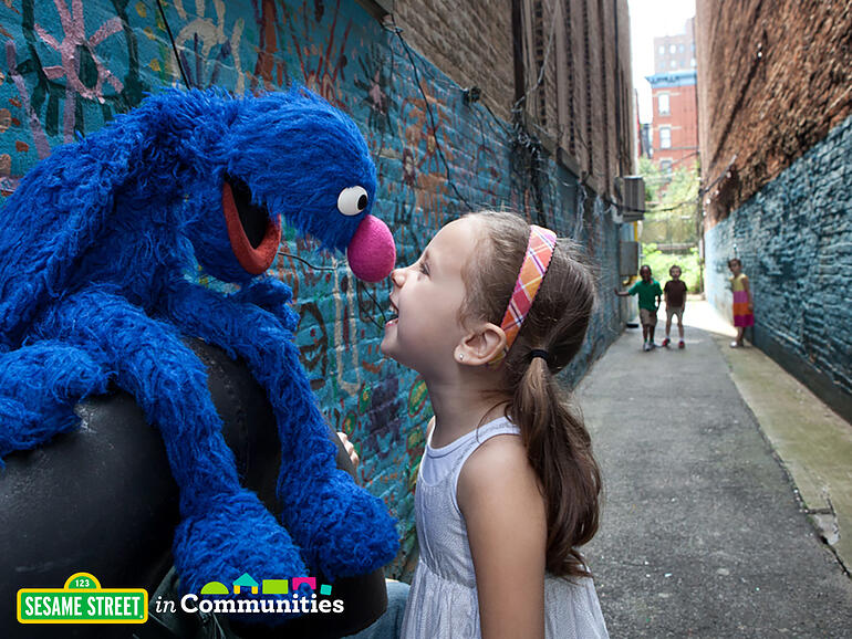 Grover plays with young girl
