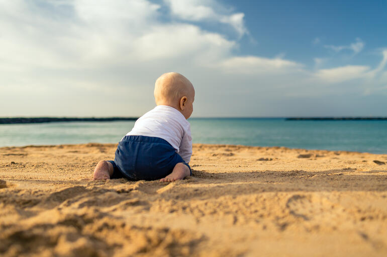 baby boy on  beach in summer