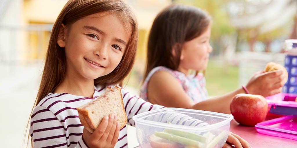 elementary-school-girls-eating-at-school-lunch