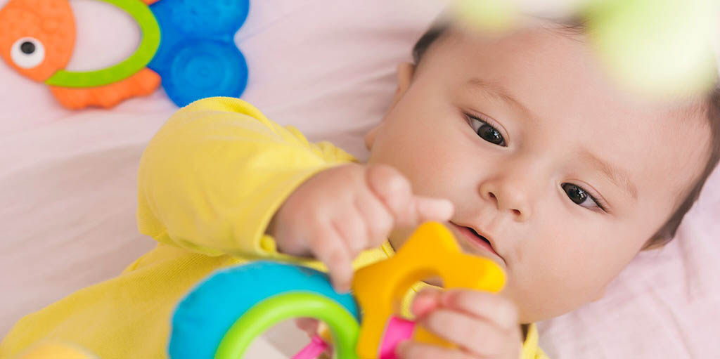 infant reaching for toy