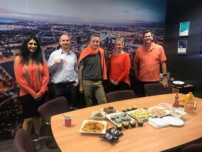 Group of SignManager staff wearing orange for Harmony Day