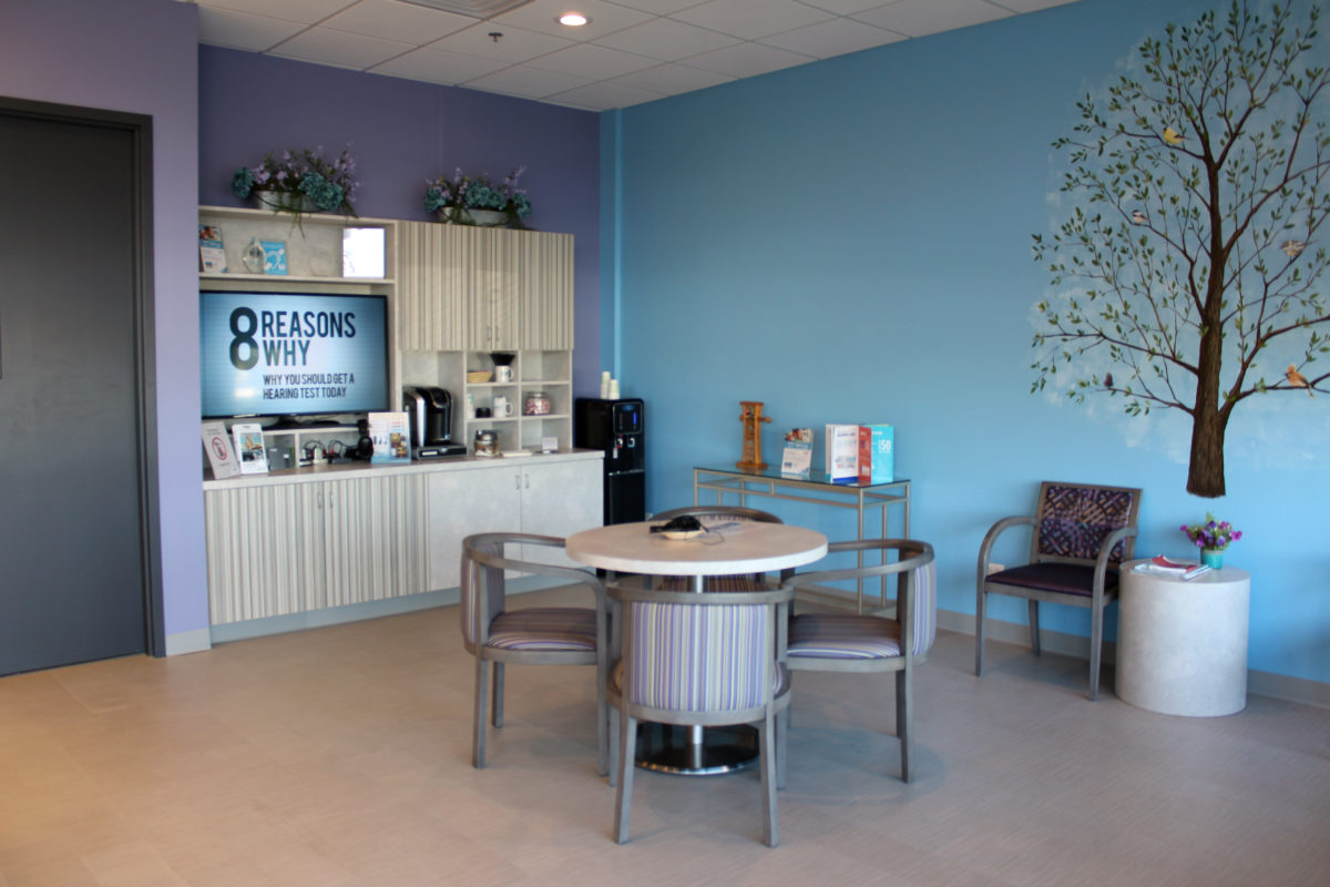 Healthcare clinic waiting room with digital signage