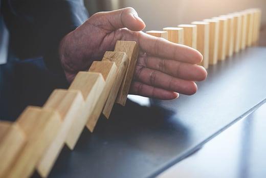 hand-stopping-domino