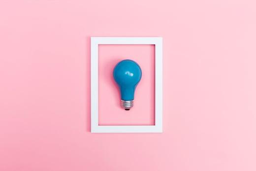 blue-lightbulb-pink-background