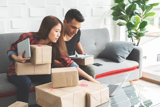 couple-with-parcels-on-sofa