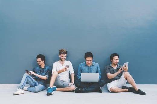 people-sitting-on-floor-checking-phones