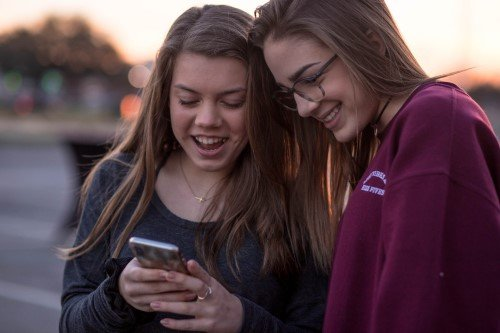 Teen Girls Looking at Smartphone