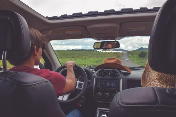 car with cowboy hat on dash