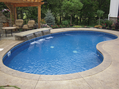 feng shui kidney shaped swimming pool resized 600
