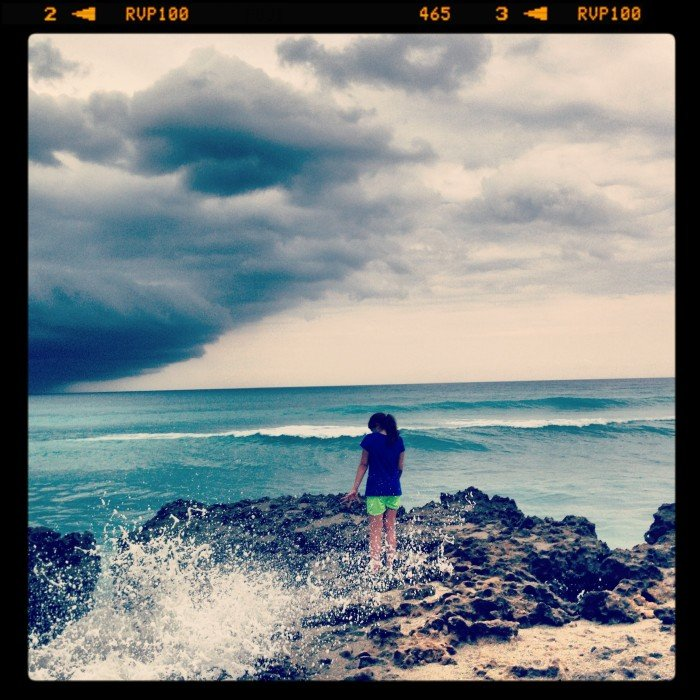 My daughter taking in the wonder of God at the ocean.
