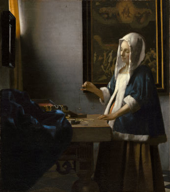 vermeer paintings woman holding balance