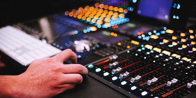 Hand mixing sound panel - audio engineering