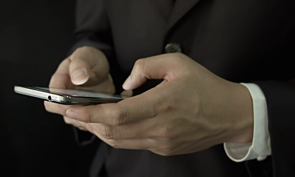 lawyer typing into mobile phone