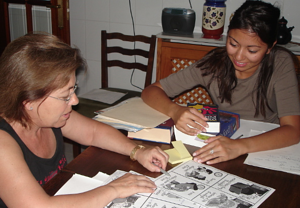 A GeoVisions homestay tutor with her host mom learning English.