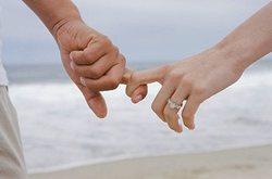 Holding hands on the beach