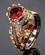 Red beryl ring with diamonds