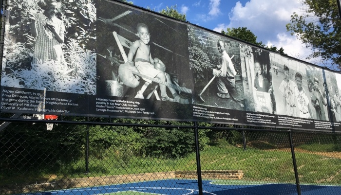 Fence lined with Teenie Harris photos in August Wilson Park