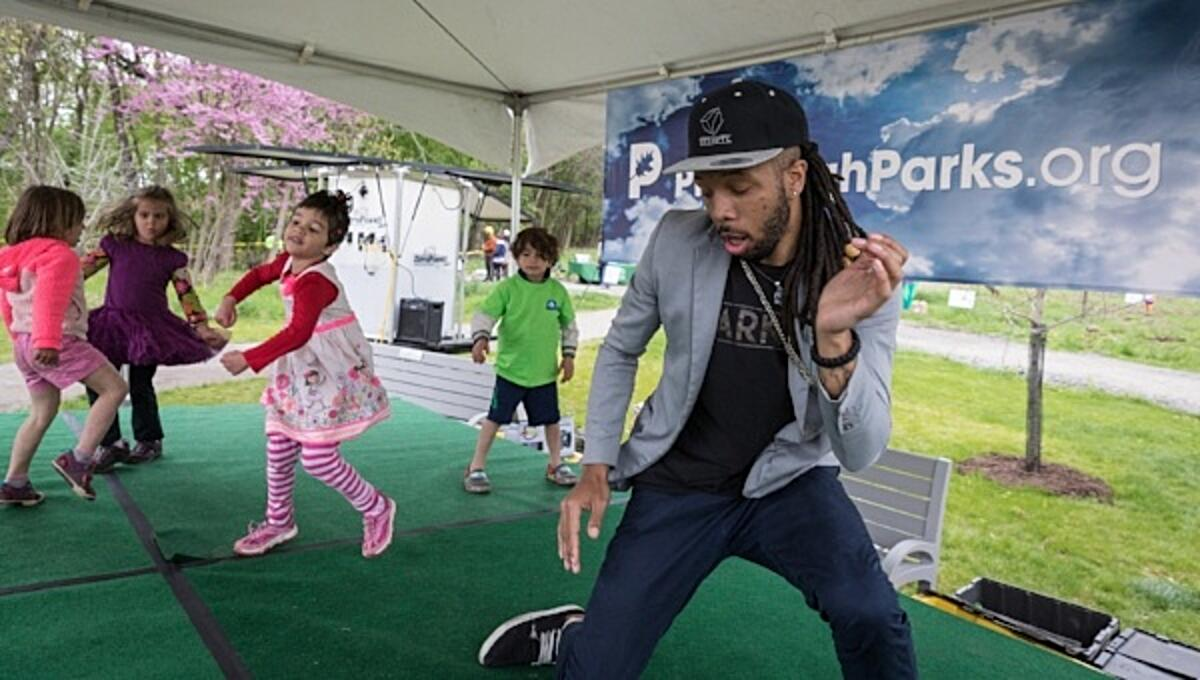 Image of people dancing at Earth Day