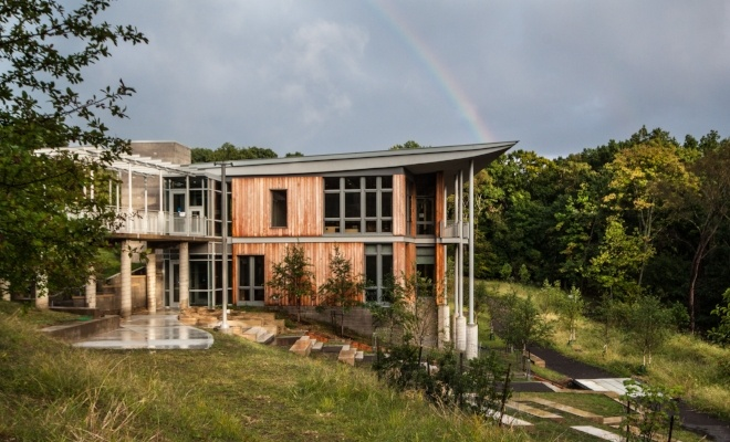 Image of the Frick Environmental Center with a rainbow