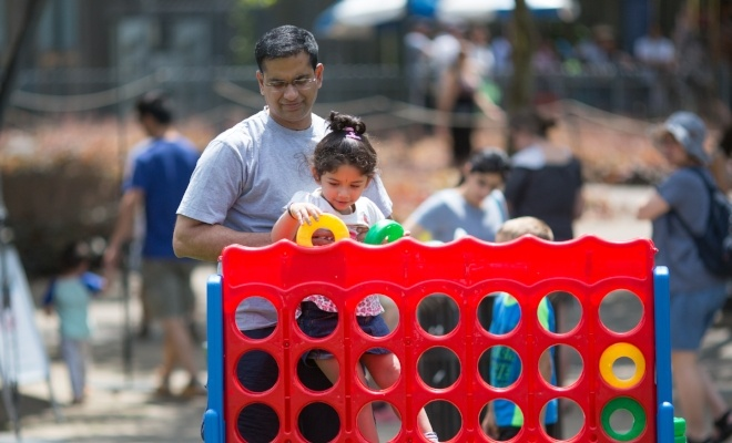 Image of a father and daughter at Kids' Day in Schenley Plaza