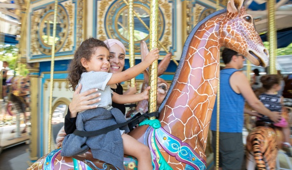 Image of a woman and little girl on the PNC Carousel