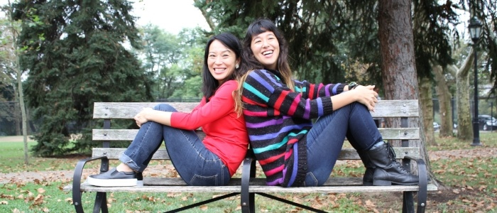Photo of Sha and Sylvia sitting on a park bench