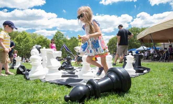 Image of kids playing giant chess in the park